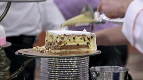 White wedding cake with serves on wedding party stock video footage