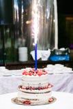 White wedding cake on the table Royalty Free Stock Photos