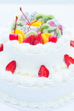 White wedding cake topped with fruit. Royalty Free Stock Photography