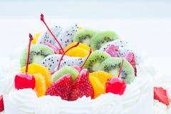 White wedding cake topped with fruit. Stock Photo