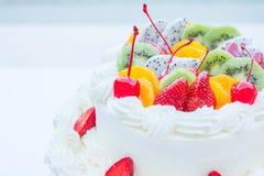 White wedding cake topped with fruit. Royalty Free Stock Photo