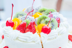 White wedding cake topped with fruit. Stock Photography