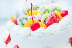White wedding cake topped with fruit. Stock Image