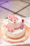 White wedding cake on wedding banquet with red rose and other flowers Stock Photo