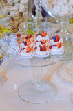 White wedding cakes meringue on wedding table. White sugar cake with pieces of strawberries and blueberries on the plate stock photography