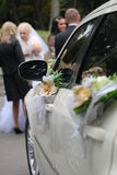 White wedding car. With flowers on side Stock Image
