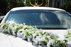 White wedding car with flowers Royalty Free Stock Photos