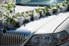 White wedding car with flowers Royalty Free Stock Photo