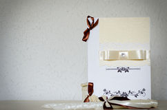 White wedding card with ribbons and place for text Stock Photo