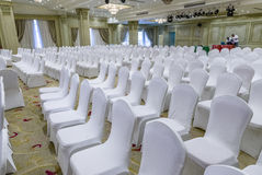 White Wedding Chairs. In a Wedding Hall Stock Photos