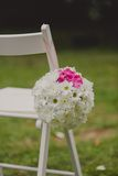 White wedding chairs with beautiful flower Stock Photography
