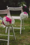 White wedding chairs with beautiful flower Stock Image