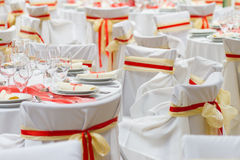 White wedding chairs with silk ribbons Royalty Free Stock Photos