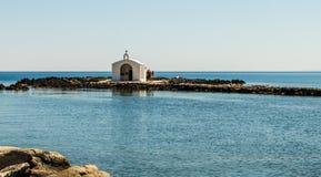White wedding chapel out in the sea in Georgioupoli village Crete Island, Greece royalty free stock photo
