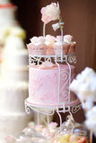 White wedding cupcake cake decorated with flowers Royalty Free Stock Photo