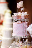 White wedding cupkace cake decorated with flowers Royalty Free Stock Image