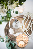 White wedding decor, perfume, pearl beads and bouquet of flowers Stock Photography
