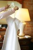 White wedding dress. Bride looking at wedding dress Royalty Free Stock Photo