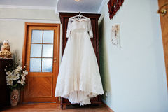 White wedding dress of bride on hangers at closet. Royalty Free Stock Photos