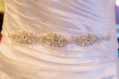 White Wedding Dress Detail. Wedding dress detail from a beautiful dress before the ceremony Stock Photo