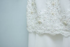 White wedding dress. Details with plain background Royalty Free Stock Photos