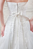White wedding dress, dressed for the bride, a fragment. Stock Images