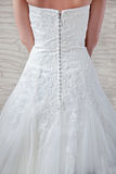 White wedding dress, dressed for the bride, a fragment. Stock Image