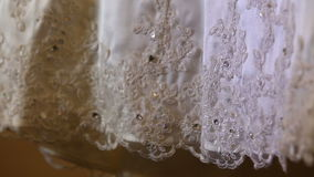 White wedding dress with hand embroidery and stones stock video footage