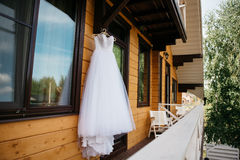 White wedding dress hanging on the balcony Stock Photography