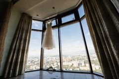 White wedding dress hanging in the bedroom. White bride dress stock images