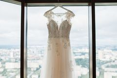 White wedding dress hanging in the bedroom. White bride dress stock photos