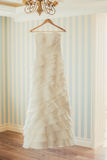 White Wedding dress hanging on a shoulders. Stock Image