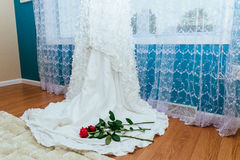 White wedding dress red rose Royalty Free Stock Photography