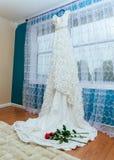White wedding dress red rose Stock Photos