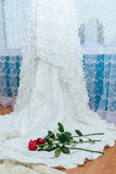 White wedding dress red rose. The perfect wedding dress with a full skirt in the room wedding dress hold red rose Stock Photos