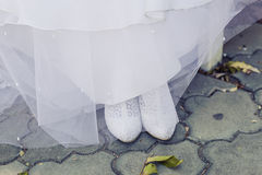 White wedding dress and shoes Royalty Free Stock Photography