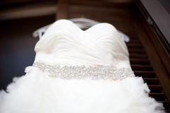 White wedding dress hanging on a shoulders Stock Photo