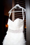 White wedding dress hanging on a shoulders Royalty Free Stock Photo