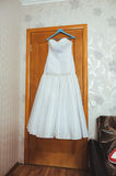 White Wedding dress on a shoulders, before ceremony Royalty Free Stock Image
