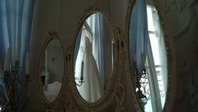 White wedding dress. White luxury wedding dress indoors stock video