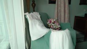 White wedding dress. White luxury wedding dress indoors stock video footage