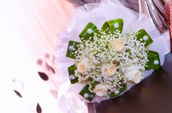 White wedding and engagement flower bouquet. Beautiful wedding bouquet with different flowers, roses. wedding rings and wedding de royalty free stock photos