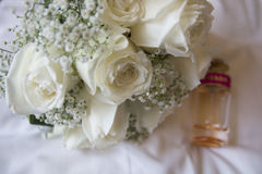 White Wedding Flowers. Babies breath and perfume bottle Royalty Free Stock Photo