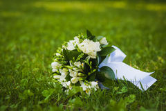 White wedding flowers on the green grass Stock Photo