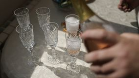 White wedding glasses with rhinestones are on the table. White wedding glasses with rhinestones and handmade are on the table stock footage