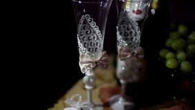 White wedding glasses with rhinestones are on the table. White wedding glasses with rhinestones and handmade are on the table stock video