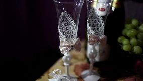 White wedding glasses with rhinestones are on the table. White wedding glasses with rhinestones and handmade are on the table stock video footage