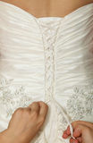 White wedding gown, corset lacing Royalty Free Stock Photography