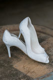 White Wedding High Heel Shoes. High heel shoes in white for a wedding ceremony to be worn by the bride Royalty Free Stock Image