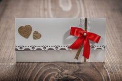 White wedding invitation card on wood Stock Photo